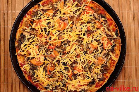 Пицца выпекается